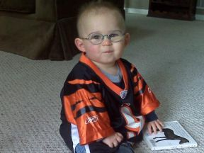 Noah, 13 months.  He wears glasses for farsightedness.