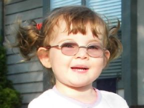 Peyton, 2 years old.  She learned she needed glasses for farsightedness and esotropia the day after her second birthday.  Her glasses are Fisher Price Marshmallow from Optometric World.