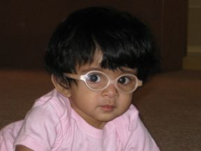 baby girl in glasses for farsightedness