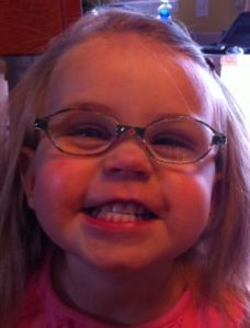 toddler girl wearing glasses for farsightedness and accommodative esotropia