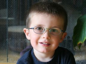 picture of a three year old boy in glasses for farsightedness
