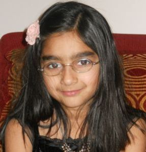 Salena, 8 years old. She wears glasses for farsightedness and astigmatism.