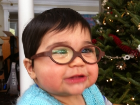 Sammy, 9 months old.  He wears glasses for farsightedness and strabismus.  Frames are Miraflex.