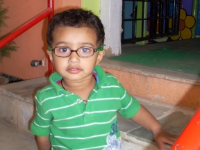Satya, 2 years old - wears glasses to correct an intermittent squint (strabismus) due to farsightedness.  He just started wearing glasses this week.