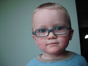 photo of a toddler boy wearing glasses