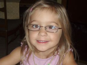 photo of a toddler girl wearing glasses for strabismus