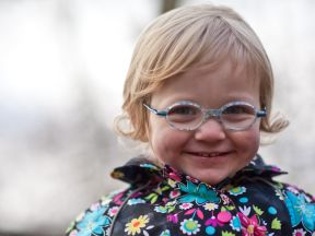 Stella, 2 years old.  She wears glasses for amblyopia and strabismus.  Frames are Lafont Tamtam 2.