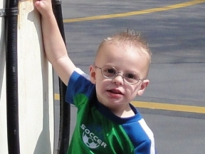 Tyler, 2 years old.  Wears glasses for farsightedness.