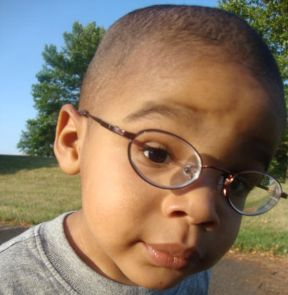 picture of toddler boy wearing glasses for nearsightedness.