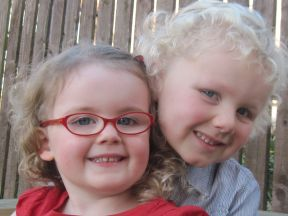 picture of young girl in glasses with older brother
