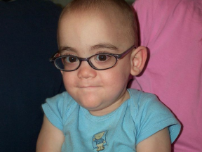 Bennett - 15 months (11 adjusted), is in glasses due to vision issues related to ROP from his early arrival at 23 weeks gestation. He was born so early that his eyes were still fused shut. He began wearing glasses the at 11 month adjusted/15 months.