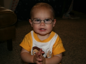 Reid - 1 year, started wearing glasses at 9 months for farsightedness. He hates his glasses, and it has been a constant battle to get him to wear them. His frames are from Excel Eye Center and they are Disney brand. I believe they have a tiny picture of Diego on them.