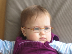 picture of a toddler wearing glasses