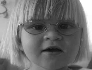 Kaiya, 27 months - wears glasses for farsightedness, and her left eye is worse than her right.  She is wearing Pink Disney Glasses with Cable Temple arms.