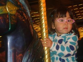 Mia, 2 years old - wears glasses for extreme farsightedness.  Her glasses frames are almost exactly like her mom's.