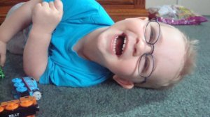 Eli's First Pair of Glasses, by Becky.  Eli wears glasses for farsightedness.