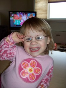 Pardon me, I can see, by Barb.  Kaylee wears glasses for strabismus and amblyopia.