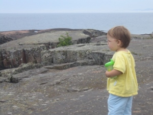 Zoe looks out over Lake Superior
