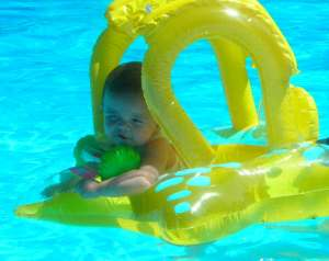 "Mia in the pool with her ""PopEye squint"""