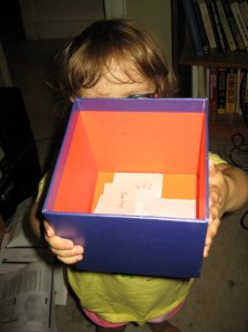 we put everyone's name in a box - with extra entries for anyone who qualified.  Zoe insisted on having her name in there, too.  I figured I'd just have her pull another name if her's came up.