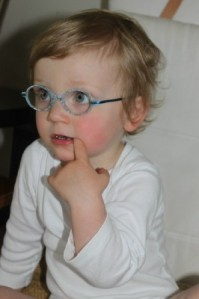 Stella, back in May, on her first day with glasses. (She was 20 months old.)