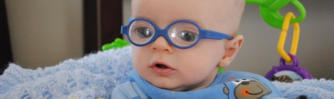 3 month old boy wearing glasses for congenital cataracts