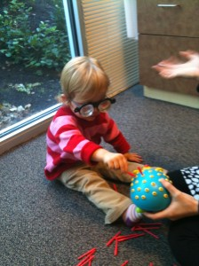 toddler wearing therapeutic prism lenses during vision therapy