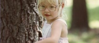 picture of a young girl in glasses from the '80s