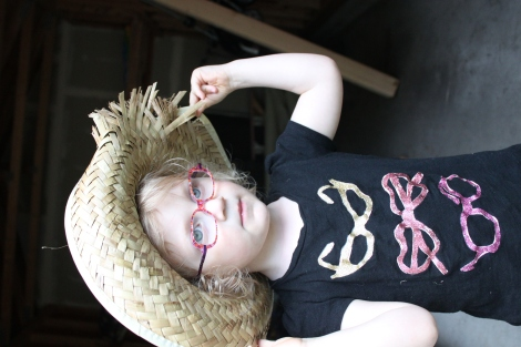 Yes, we buy every cute glasses-themed T-shirt we see. Busted farmer's hat? Not a typical accessory.