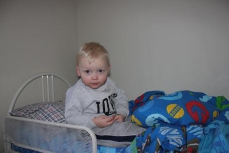 Joel enjoying his new toddler bed two months post Strabismus Surgery #2.