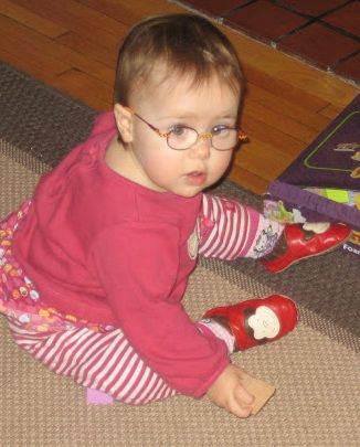 Zoe's first day in glasses.  The glasses came off shortly after this picture was taken.