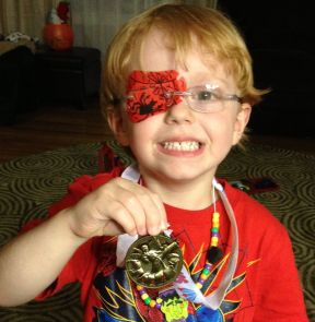 Here is a picture of my son Jaymeson who is almost 4. He is showing off his karate medal. He has Refractive Amblyopia and has been patching for about 7 months.