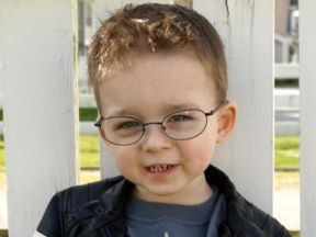 Carter, 2 1/2 years old.  He wears glasses for farsightedness.