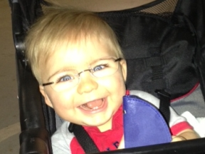 Nash, 10 months old.  He wears glasses for farsightedness and strabismus.  His frames are Silhouette.