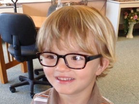 Sawyer, 3 1/2 years old.  He wears glasses for farsightedness, astigmatism, and amblyopia.  His frames are Josh Tortoise.