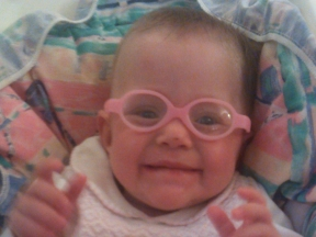 8 1/2 month old baby (4 1/2 months adjusted).  She wears Miraflex glasses for nearsightedness due to ROP.