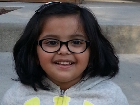 Tanya, 3 1/2 years old.  She wears glasses for astigmatism.  Frames are Ralph Lauren.