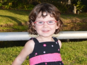 2 year old in red glasses for esotropia and hyperopia