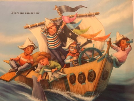 "Page from the book.  Five children are riding on a ship with colorful flags. One girl is petting a dolphin.  The text on the page reads, ""Everyone can see me."""
